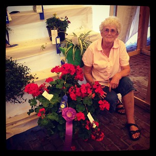 My Grandma won Grand Champion for her flowers at Corn School!