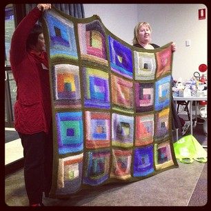 Amazing log cabin blanket from Sharon. #knitcamp