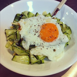 "Lunch: Zucchini Ribbon ""Pasta"" with Fried Egg & Pecorino. Recipe here: http://www.seriouseats.com/2012/08/zucchini-ribbon-pasta-with-fried-egg-and-peco.html #paleo #yum"
