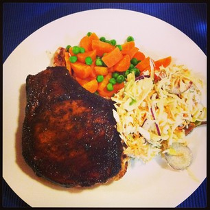 Massive pork chop (courtesy of Meat Emporium), coleslaw, and veg. #paleo #yum