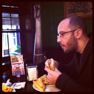 Mr Snook tries to ignore the giant wooden emu staring at his burger.