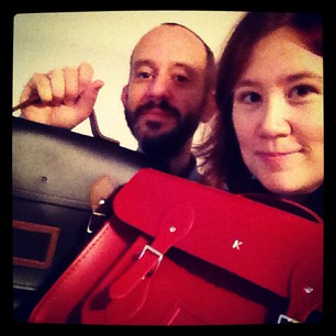 He got us matching Cambridge Satchels, and they're EMBOSSED! #hipster #squee
