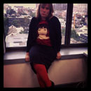 Black pencil skirt, Liza Minelli concert T-shirt, cardigan, orange tights
