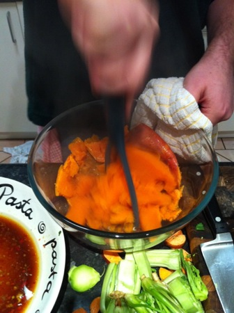 Mashing the sweet potatoes